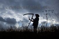 Farmworker with scythe Norfolk UK (EAJ009041)